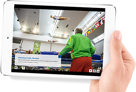 Human hand holding an iPad showing the Trampolonepics Gallery with an image of World Cup Loulé, Portugal 2015